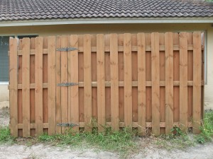 Custom wood fence to cover up water filter